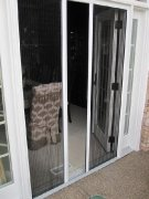 Double Plisse Retractable Screen - Half Open, Half Retracted