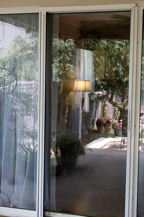 Plisse sliding glass retractable door screens for Retractable sliding door