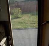 Looking Out Through the Plisse Retractable Screen on the Templeton's Revcon RV