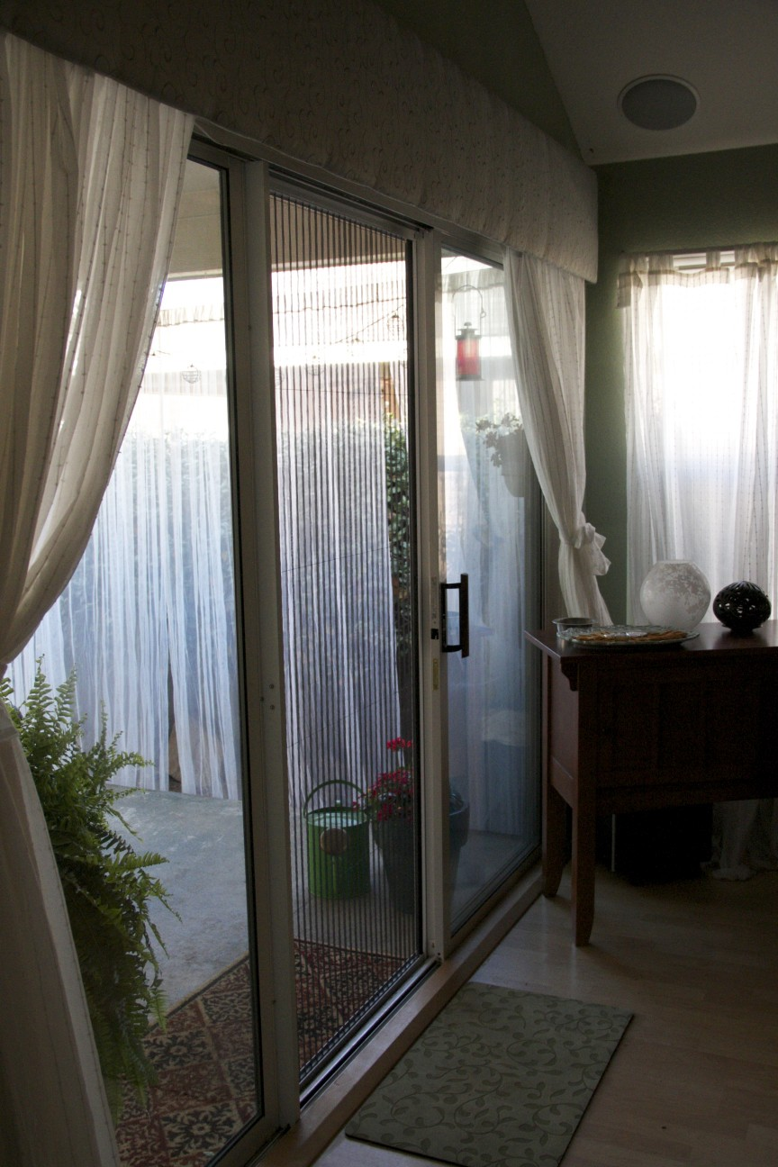 Single White Plisse Retractable Screen Show in Use on a Sliding Glass Door