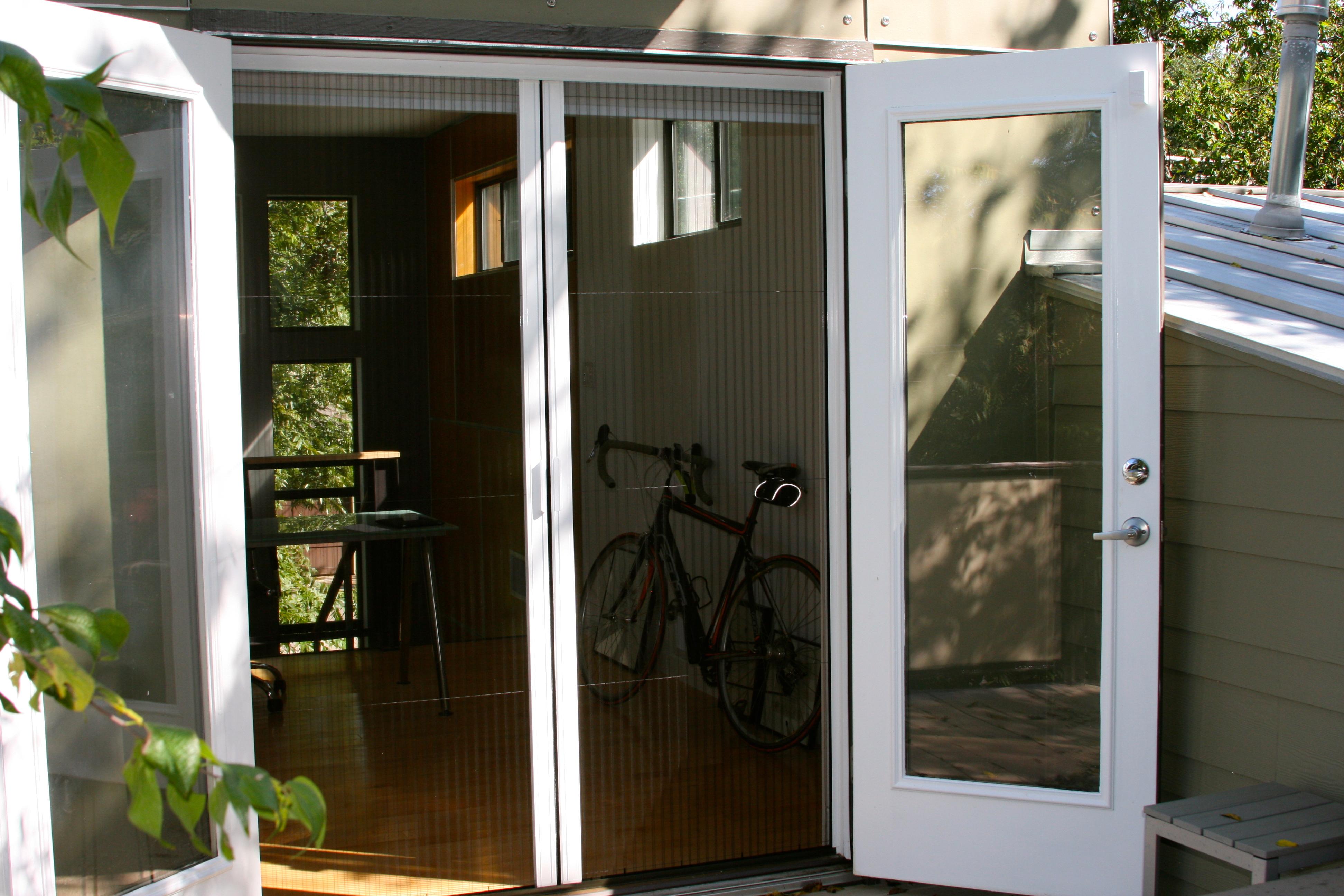 Plisse double door retractable screen galleryretractable for Retractable screen door for double front door