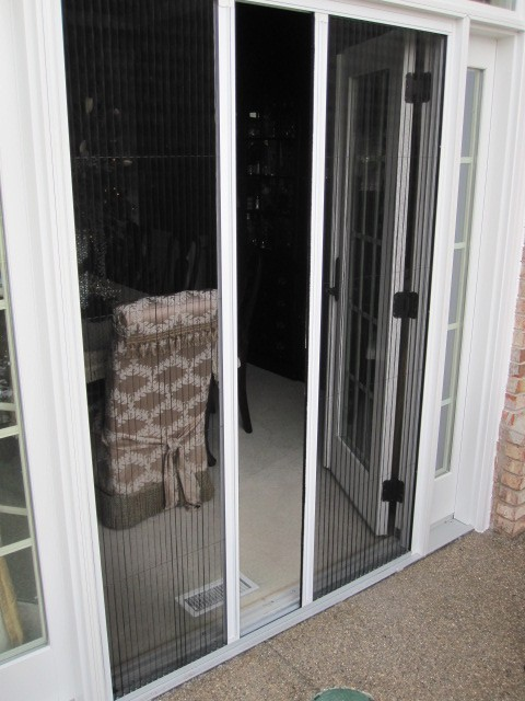 Double Plisse Retractable Screen Partially Open on Atrium Doorway