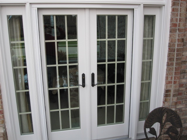 Double Plisse Retractable Screen Retracted Back on Atrium Doorway