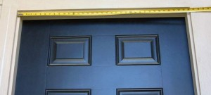 Picture of Standard Entry Doorway with Tape Measure Across Width of Opening at Top