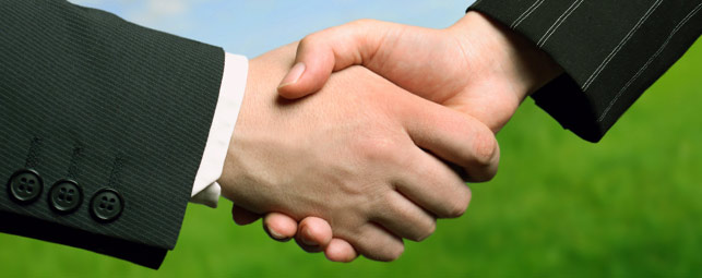 Image of hands shaking, symbolic of Screen Solutions' business relationship with their dealers.