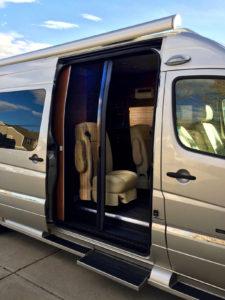 Retractable screen door shown half open on a RoadTrek conversion van.